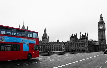 Image of bus and parliament - JFG Comms summary of transport and infrastructure announcements in spring budget