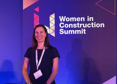 Women smiling at women in construction summit
